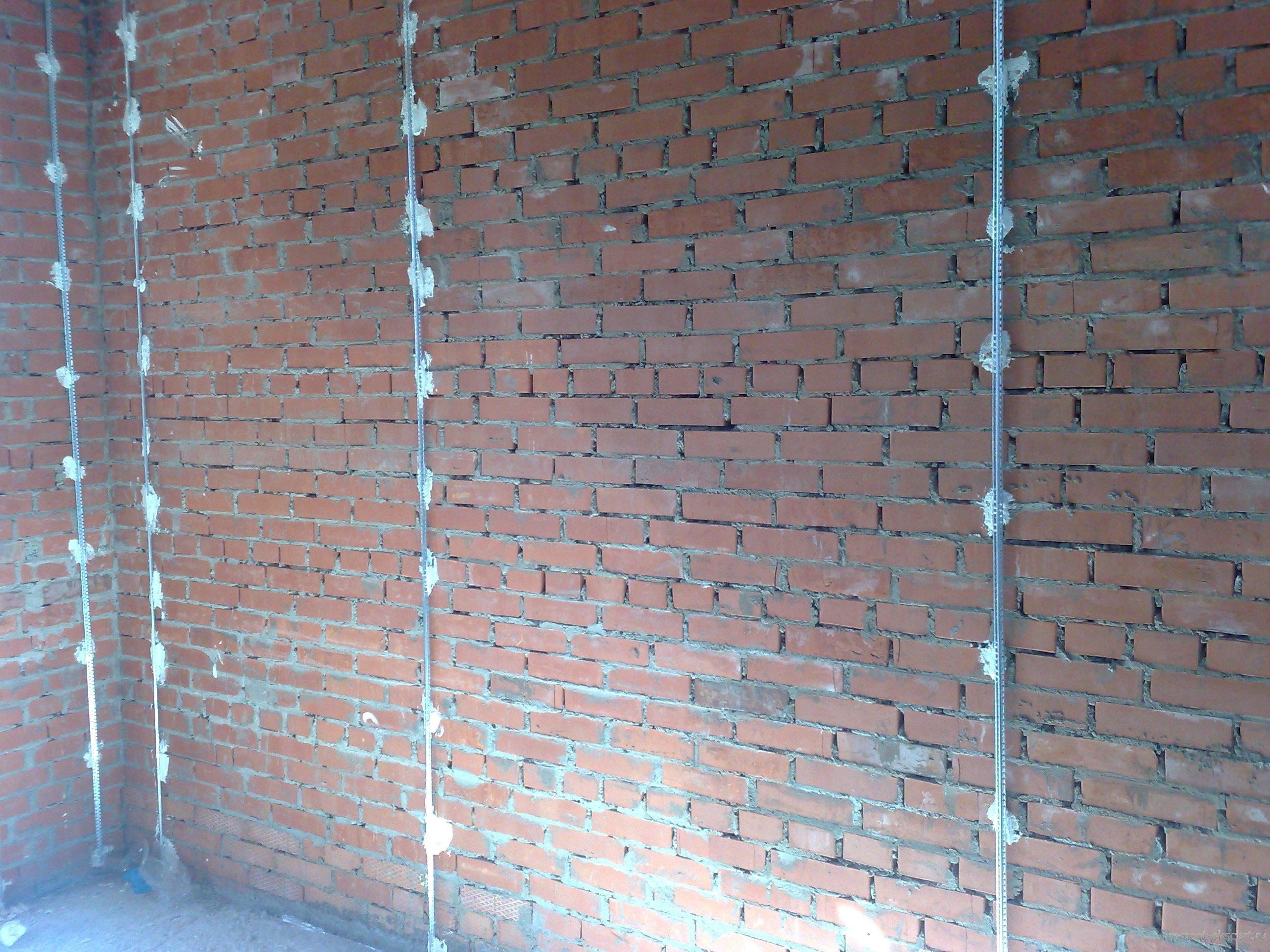 Установка маяков под штукатурку стен